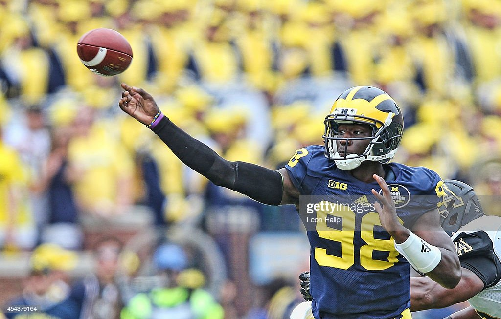 Quarterback Devin Gardner #98 of the Michigan Wolverines pass during the first half od the game against Appalachian State at Michigan Stadium on August 30, 2014 in Ann Arbor, Michigan.