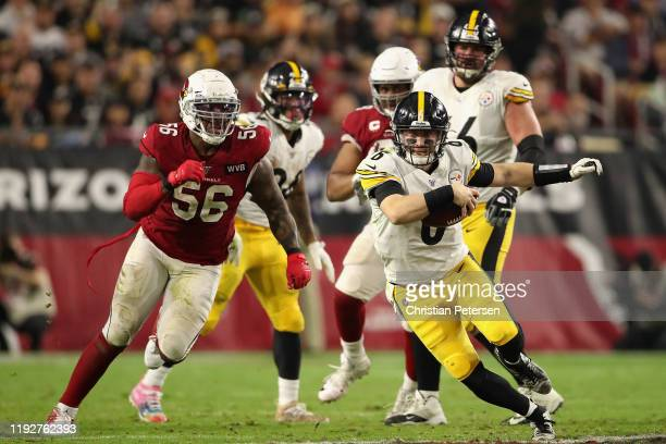 Quarterback Devlin Hodges of the Pittsburgh Steelers scrambles with the football ahead of linebacker Terrell Suggs of the Arizona Cardinals during...
