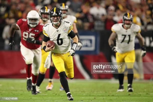 Quarterback Devlin Hodges of the Pittsburgh Steelers scrambles with the football against the Arizona Cardinals during the first half of the NFL game...