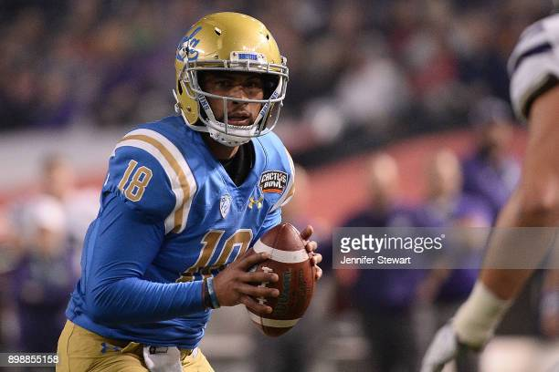 Quarterback Devon Modster of the UCLA Bruins looks to make a pass against the Kansas State Wildcats in the first half of the Cactus Bowl at Chase...