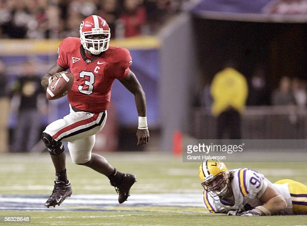 Quarterback DJ Shockley of the Georgia Bulldogs breaks away from Chase Pittman of the Louisiana State University Tigers during the 2005 SEC Football...