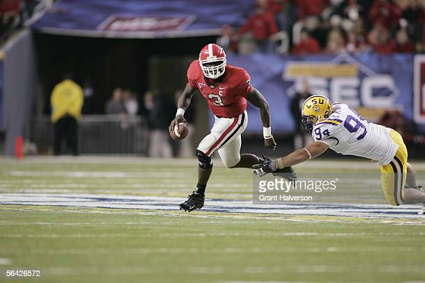 Quarterback DJ Shockley of the Georgia Bulldogs carries the ball against the LSU Tigers during the 2005 SEC Football Championship Game at the Georgia...