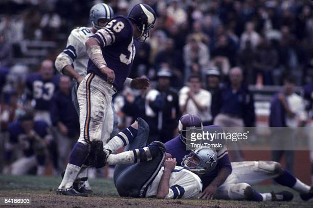 Quarterback Don Meredith of the Dallas Cowboys is sacked by Jim Marshall of the Minnesota Vikings during the Playoff Bowl Game on January 5 1969 at...
