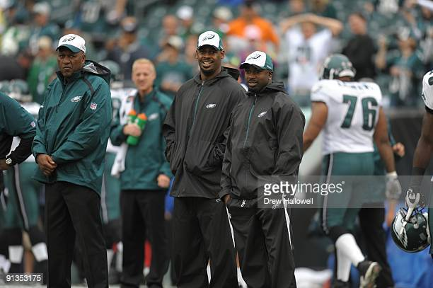 Quarterback Donovan McNabb and running back Brian Westbrook of the Philadelphia Eagles watch warmups during the game against the Kansas City Chiefs...