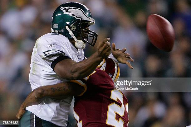 Quarterback Donovan McNabb of the Philadelphia Eagle is sacked by Sean Taylor of the Washington Redskins at Lincoln Financial Field on September 17...