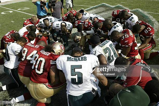 Quarterback Donovan McNabb of the Philadelphia Eagles and other members of the Eagles and San Francisco 49ers say a post-game prayer at Lincoln...