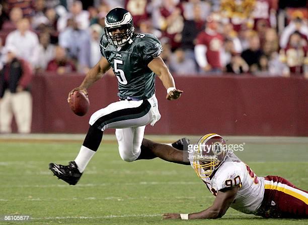 Quarterback Donovan McNabb of the Philadelphia Eagles evades defensive end Nic Clemons of the Washington Redskinss on November 6 2005 at FedEx Field...