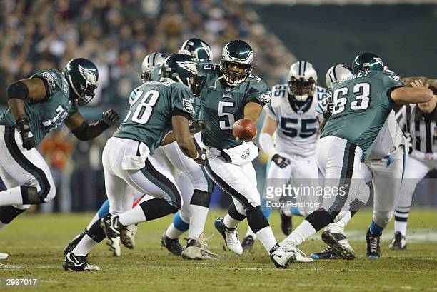 Quarterback Donovan McNabb of the Philadelphia Eagles hands the ball to his running back Correll Buckhalter during the NFC Championship game against...