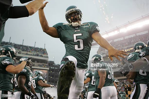 Quarterback Donovan McNabb of the Philadelphia Eagles high fives other players as he enters the field before the game against the Washington Redskins...