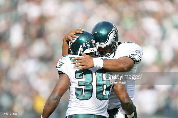 Quarterback Donovan McNabb of the Philadelphia Eagles hugs running back Brian Westbrook after a touchdown during a game against the Tampa Bay...