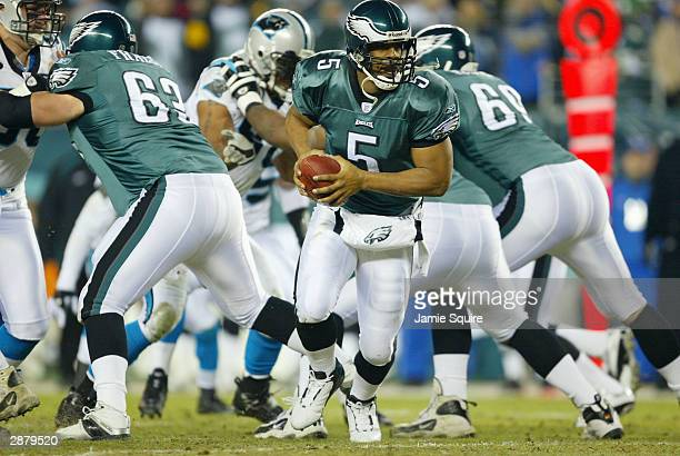 Quarterback Donovan McNabb of the Philadelphia Eagles looks to hand the football off in the first quarter against the Carolina Panthers during the...