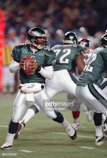 Quarterback Donovan McNabb of the Philadelphia Eagles looks to pass against the New York Giants during an NFL game December 30 2001 at Veterans...