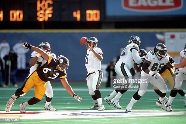 Quarterback Donovan McNabb of the Philadelphia Eagles passes while under pressure from defensive lineman Kimo von Oelhoffen of the Pittsburgh...