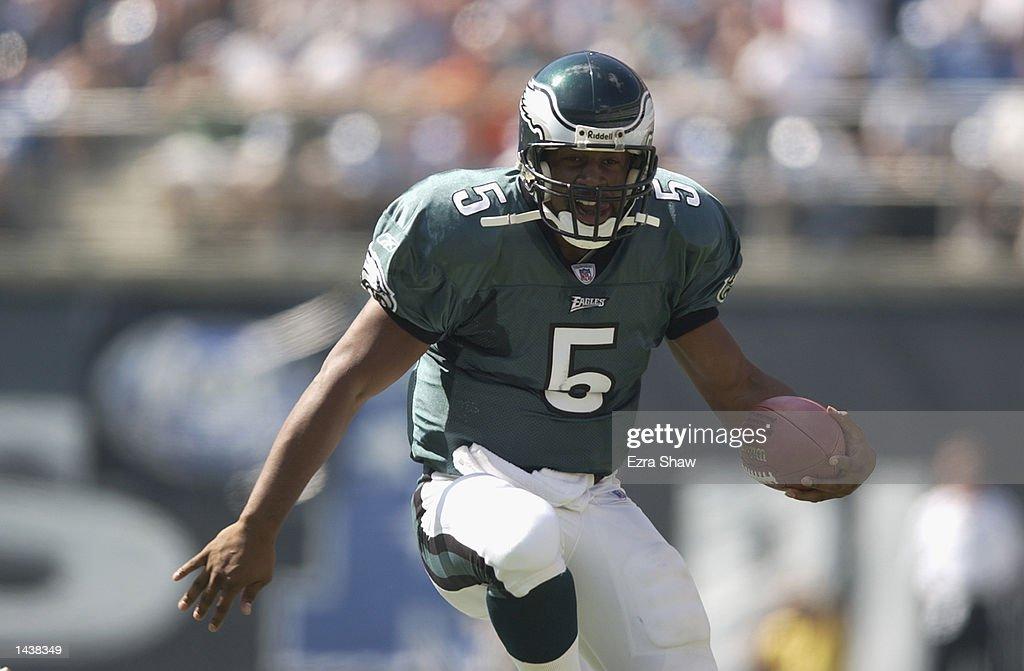 Quarterback Donovan McNabb #5 of the Philadelphia Eagles runs with the ball  during the NFL