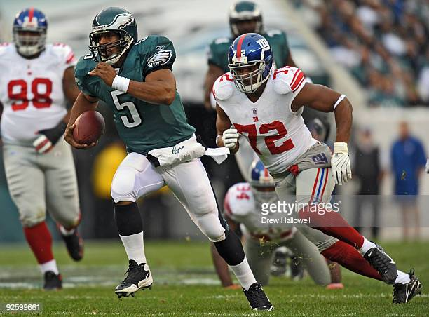 Quarterback Donovan McNabb of the Philadelphia Eagles scrambles away from defensive end Osi Umenyiora of the New York Giants on November 1 2009 at...