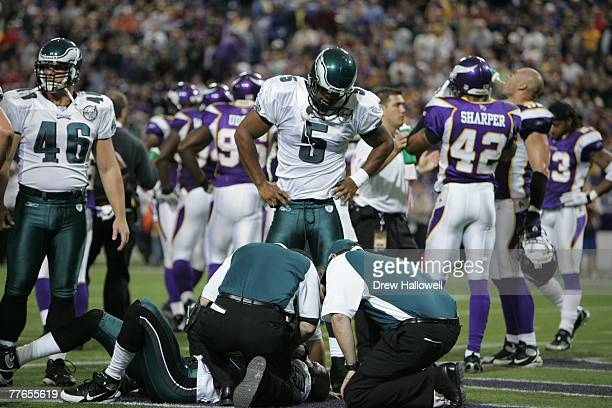 Quarterback Donovan McNabb of the Philadelphia Eagles stands over trainers and an injured player during the game against the Minnesota Vikings on...