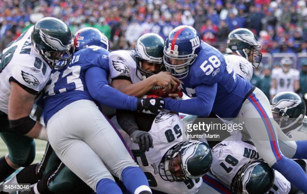 Quarterback Donovan McNabb of the Philadelphia Eagles stretches over the pile and scores a touchdown during the NFC Divisional Playoff game against...