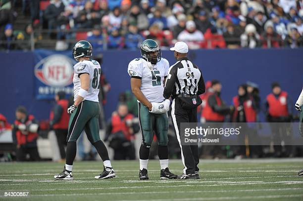 Quarterback Donovan McNabb of the Philadelphia Eagles talks to referee Mike Carey during the game against the New York Giants on January 11, 2009 at...