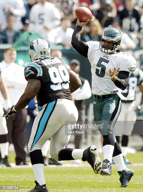 Quarterback Donovan McNabb of the Philadelphia Eagles throws against Brentson Buckner of the Carolina Panthers on October 17 2004 at Lincoln...