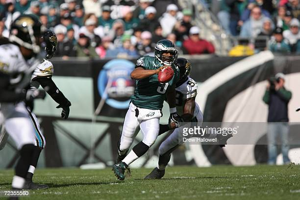 Quarterback Donovan McNabb of the Philadelphia Eagles tries to scramble away from defensive end Bobby McCray of the Jacksonville Jaguars on October...