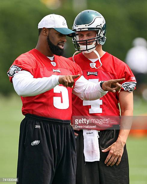 Quarterback Donovan McNabb talks with rookie quarterback Kevin Kolb of the Philadelphia Eagles during minicamp on May 12 2007 at the NovaCare Complex...