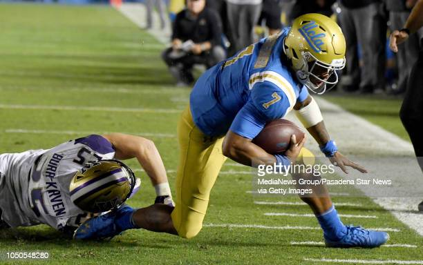 Quarterback Dorian ThompsonRobinson of the UCLA Bruins scrambles for a first down past linebacker Ben BurrKirven of the Washington Huskies in the...