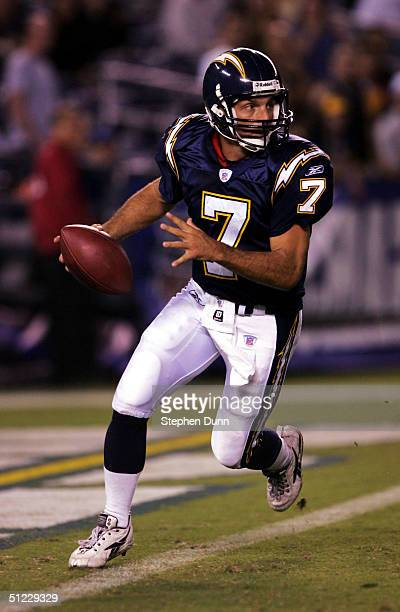 Quarterback Doug Flutie of the San Diego Chargers rolls out with the ball against the Seattle Seahawks in their preseason game on August 27 2004 at...