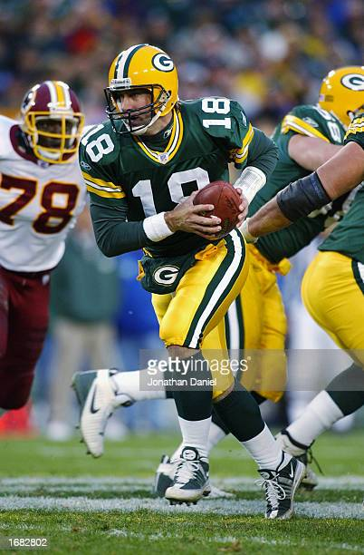 Quarterback Doug Pederson of the Green Bay Packers advances the ball during the NFL game against the Washington Redskins at Lambeau Field on October...