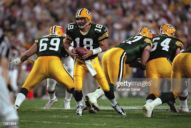 Quarterback Doug Pederson of the Green Bay Packers attempts a hand off during the NFL Monday Night Football game against the Cleveland Browns on...