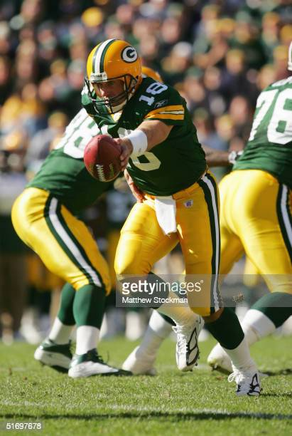 Quarterback Doug Pederson of the Green Bay Packers attempts a handoff against the New York Giants on October 3 2004 at Lambeau Field in Green Bay...
