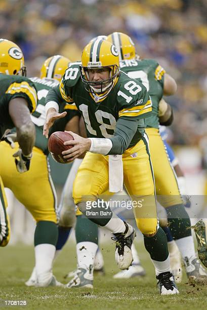Quarterback Doug Pederson of the Green Bay Packers moves the ball during the NFL game against the Detroit Lions at Lambeau Field on November 10 2002...