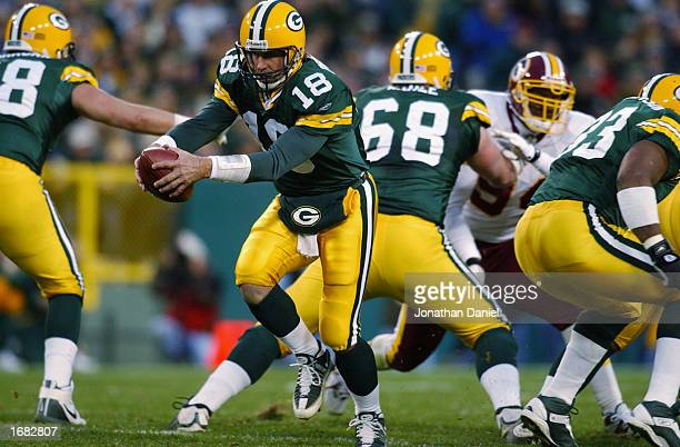 Quarterback Doug Pederson of the Green Bay Packers prepares to hand off during the NFL game against the Washington Redskins at Lambeau Field on...