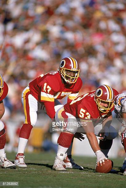 Quarterback Doug Williams of the Washington Redskins calls a play at the line of Scrimmage against the Arizona Cardinals during a game at Sun Devil...