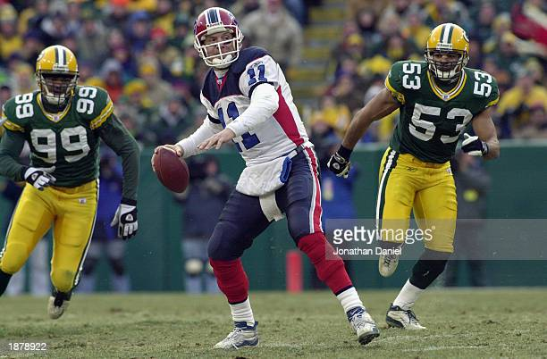 Quarterback Drew Bledsoe of the Buffalo Bills looks downfield to throw under pressure from linebacker Paris Lenon and defensive end Jamal Reynolds of...