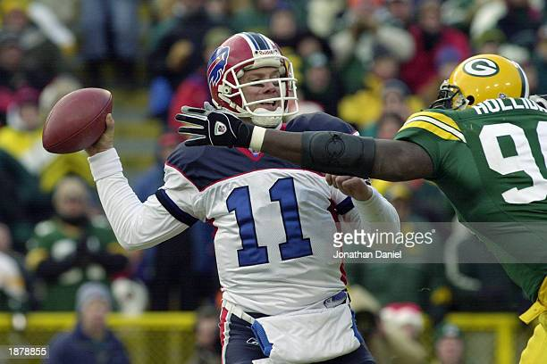 Quarterback Drew Bledsoe of the Buffalo Bills throws a pass as Vonnie Holliday of the Green Bay Packers defends during the game at Lambeau Field on...