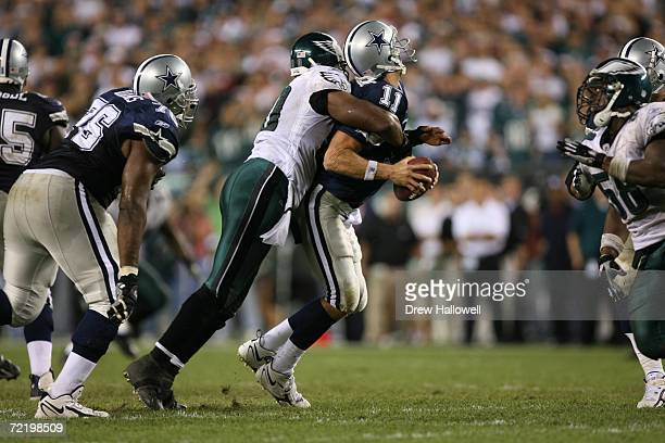 Quarterback Drew Bledsoe of the Dallas Cowboys gets sacked by defensive end Darren Howard of the Philadelphia Eagles on October 8, 2006 at Lincoln...