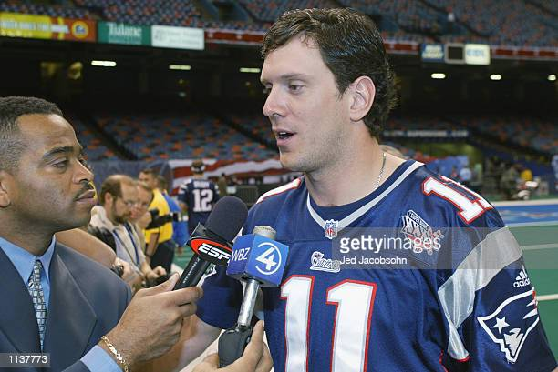 Quarterback Drew Bledsoe of the New England Patriots speaks with ESPN's Stuart Scott during Super Bowl XXXVI Media Day on January 29 2002 at the...