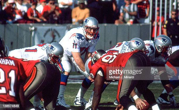 Quarterback Drew Bledsoe of the New England Patriots standing next to his teammate and Right Guard Todd Rucci calls the signals from the line of...