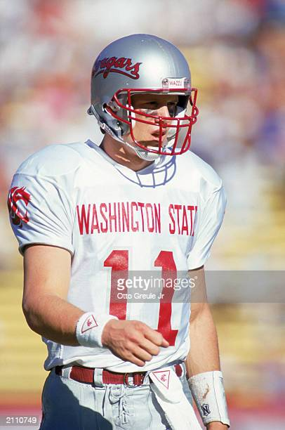 Quarterback Drew Bledsoe of the Washington State Cougars walks on the field during a game against the Stanford Cardinals on November 3 1990 in...