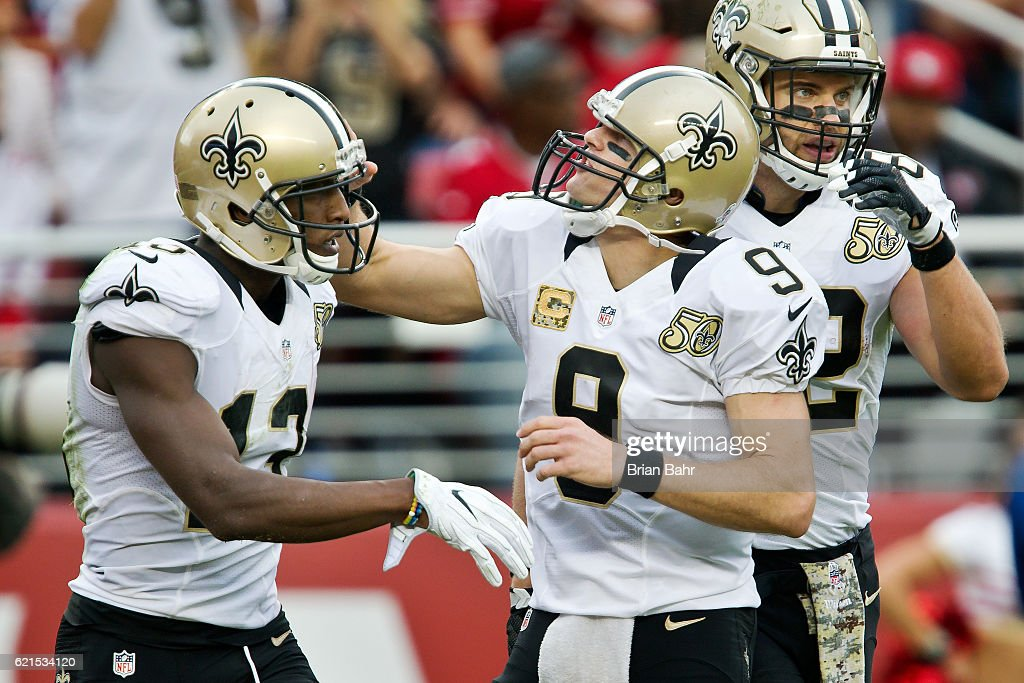 Quarterback Drew Brees #9 celebrates a touchdown with wide receiver Michael Thomas #13 of the New Orleans Saints against the San Francisco 49ers in the fourth quarter on November, 6 2016 at Levi's Stadium in Santa Clara, California. The Saints won 41-23.