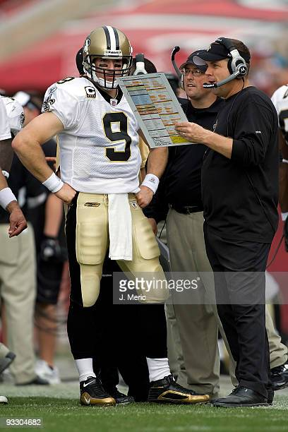 Quarterback Drew Brees of the New Orleans Saints and head coach Sean Payton talk along the sidelines during the game against the Tampa Bay Buccaneers...