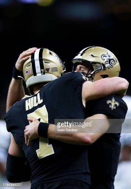 Quarterback Drew Brees of the New Orleans Saints and Taysom Hill celebrate their second touchdown in the third quarter of the game against the...