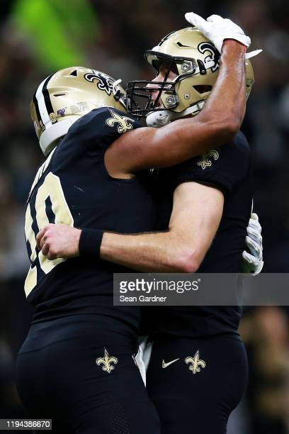 Quarterback Drew Brees of the New Orleans Saints and wide receiver Tre'Quan Smith celebrate their touchdown in the second quarter of the game against...