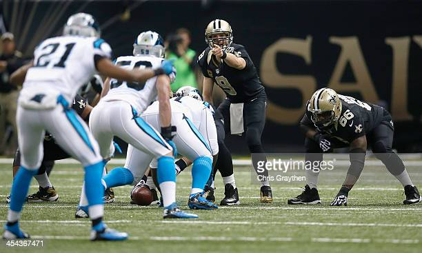 Quarterback Drew Brees of the New Orleans Saints calls a play at the line of scrimmage against the Carolina Panthers at MercedesBenz Superdome on...