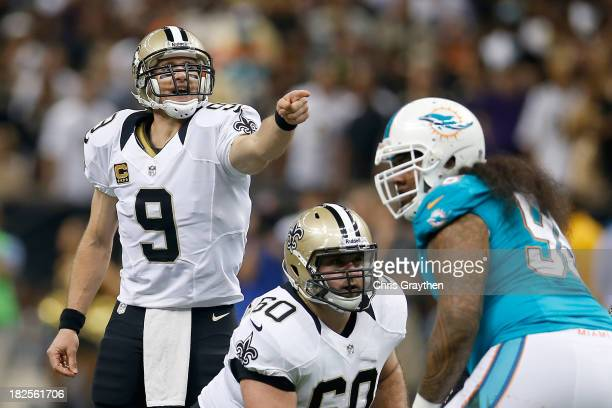 Quarterback Drew Brees of the New Orleans Saints calls out from under center in the first quarter against the Miami Dolphins at the Mercedes-Benz...