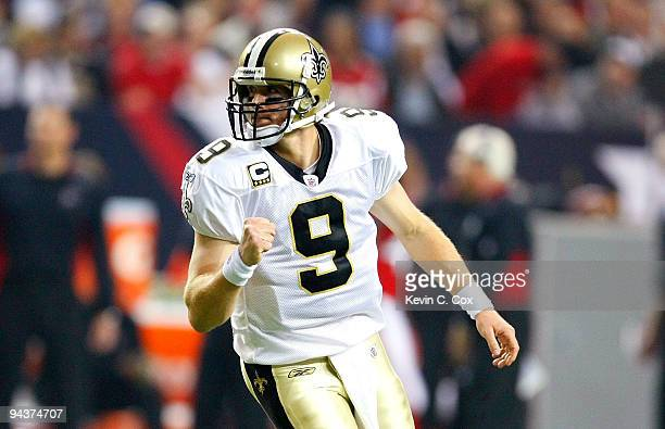 Quarterback Drew Brees of the New Orleans Saints celebrates after he threw a touchdown pass in the second quarter against the Atlanta Falcons at...