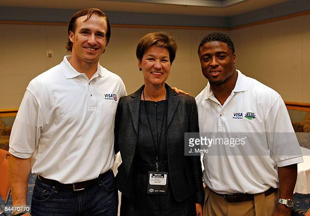 Quarterback Drew Brees of the New Orleans Saints Chief Financial Officer Alex Sink from the state of Florida and running back Warrick Dunn of the...