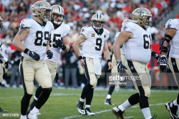 Quarterback Drew Brees of the New Orleans Saints controls the offense during the first quarter of an NFL football game against the Tampa Bay...