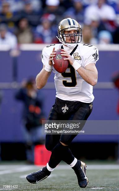 Quarterback Drew Brees of the New Orleans Saints drops back to pass against the New York Giants on December 24, 2006 at Giants Stadium in East...