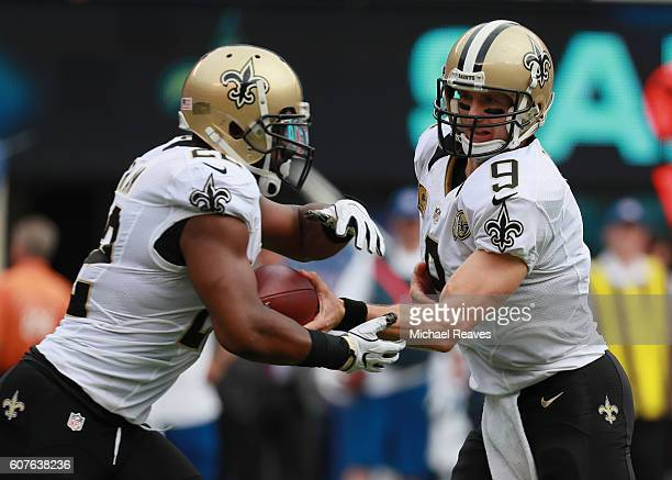 Quarterback Drew Brees of the New Orleans Saints hands off to Mark Ingram during the first quarter against the New York Giants at MetLife Stadium on...